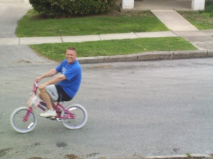 Hey, Dad! Why are you riding a pink girl bike?!